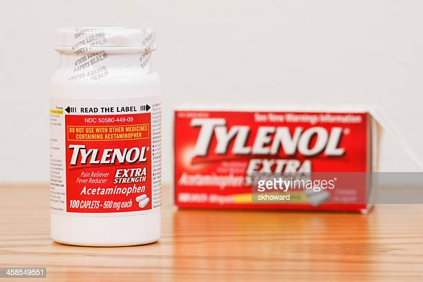 sealed bottle of extra strength tylenol caplets with box - acetaminophen stock photos and pictures