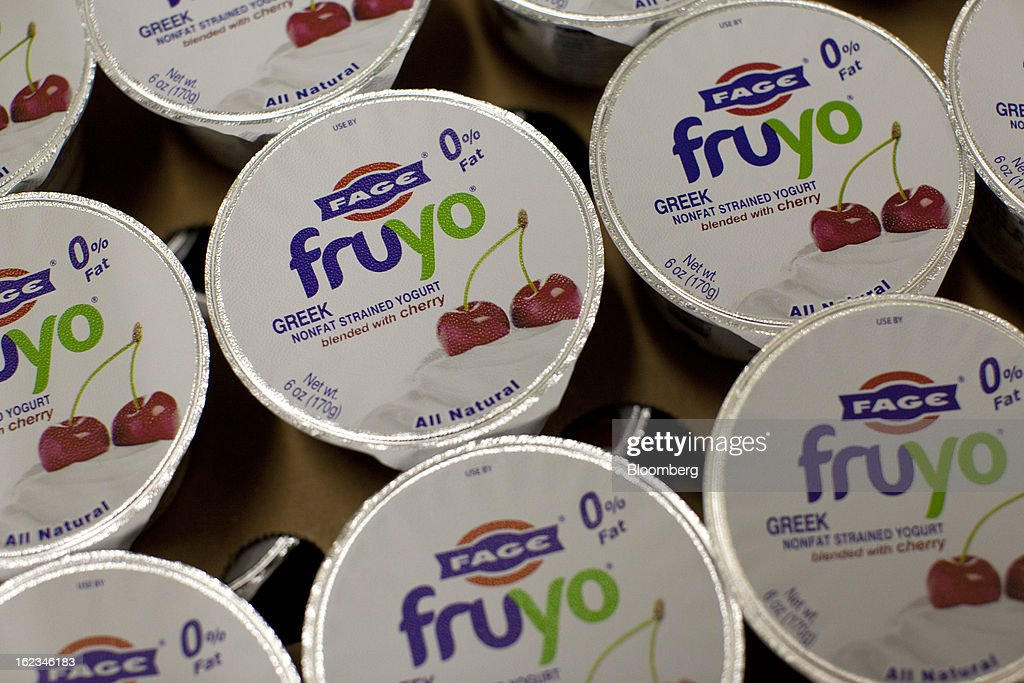 Sealed cartons of Fruyo cherry-flavoured Greek yoghurt stand after manufacture at the Fage Dairy Industry SA plant in Athens, Greece, on Thursday, Feb. 21, 2013. An October restructuring that placed Fage International SA's Greek units in a subsidiary called Fage Dairy Industry SA coincided with Coca-Cola Hellenic Bottling SA's plan to flee the epicenter of Europe's debt crisis by moving its main stock listing to London from Athens. Photographer: Kostas Tsironis/Bloomberg via Getty Images
