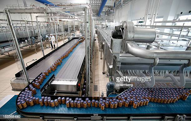 Sealed jars of pasta sauce travel along a conveyor belt at Barilla Holding SpA's new sauce packaging plant in Rubbiano near Parma Italy on Wednesday...