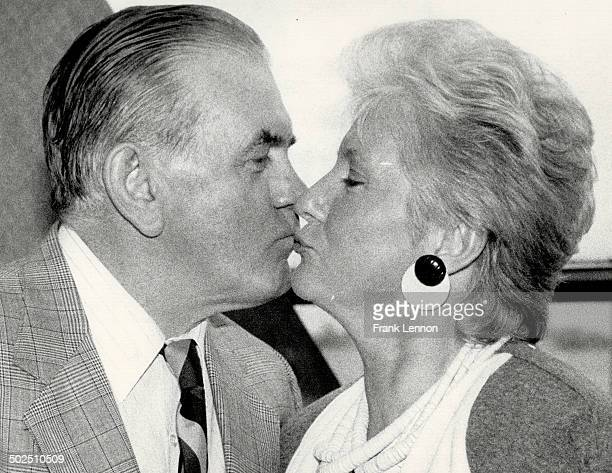 Sealed with a kiss: Hockey great Rocket Richard busses Colleen Howe at a gathering of the International Professional Hockey Alumni here yesterday....