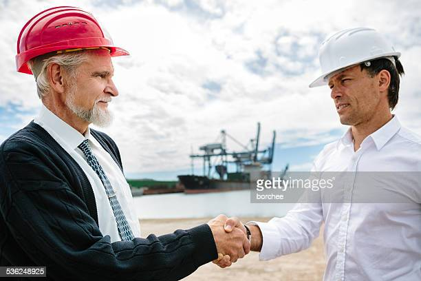 sealing the deal at the port - marine engineering stock photos and pictures