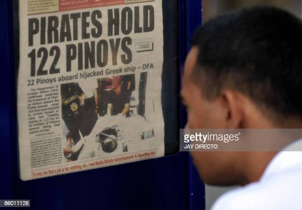 A seaman reads a copy of a newspaper in Manila on April 17 2009 reporting on Filipino seamen bieng held by Somali pirates Seventeen Filipino seamen...