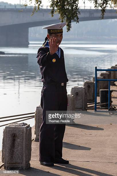 CONTENT] A seaman with the Korean People's Navy stands guard at the site of the USS Pueblo docked in Pyongyang since being captured in 1968
