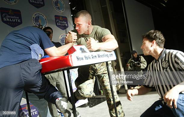 S seamen arm wrestle during the Annual Fleet Week Team/Ship Arm Wrestling Championships at the Intrepid Museum May 23 2003 in New York City Fleet...