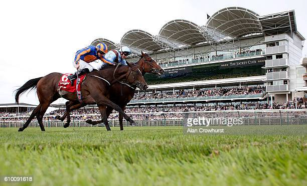 Seamie Heffernan riding Brave Anna win The Connolly's Red Mills Cheveley Park Stakes from Roly Poly and Lady Aurelia and Frankie Dettori at Newmarket...