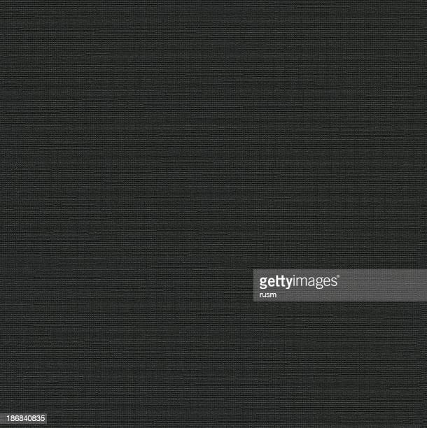 Seamless black canvas-textured paper background
