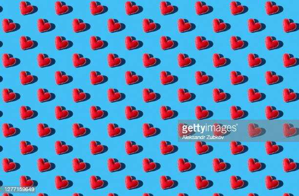 seamless pattern of red hearts on a blue background. the background of valentine's day. handmade work. - 愛 ストックフォトと画像