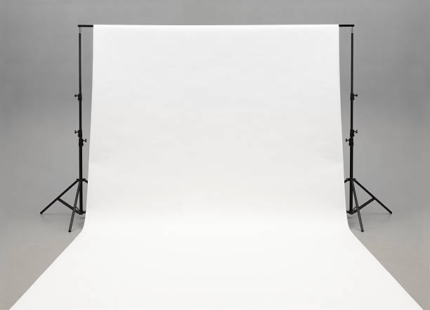 seamless white background paper hanging on stands-isolated on grey - 攝影 個照片及圖片檔