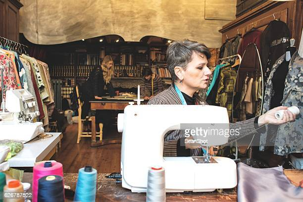 Seamstress and her Teamwork in Working Place