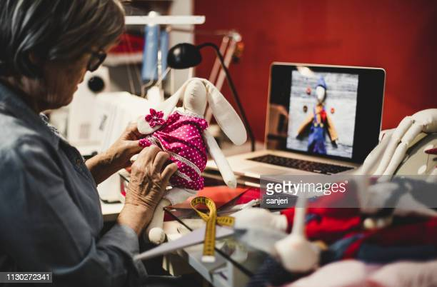 seamstress at work - puppet maker stock pictures, royalty-free photos & images
