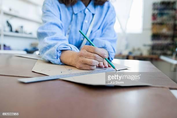 Seamstress drafting sewing pattern