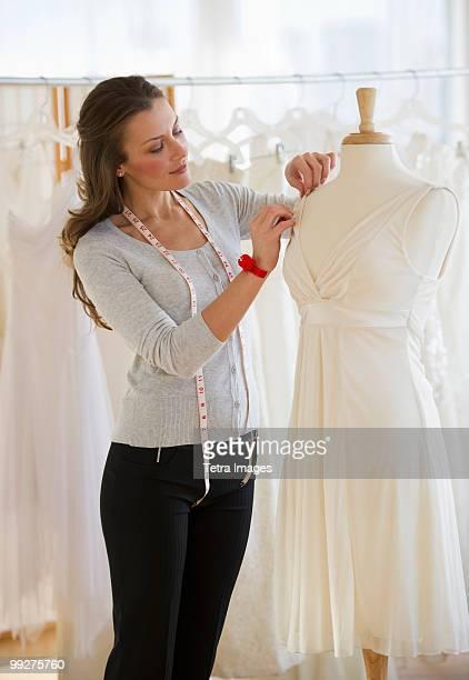 Seamstress in bridal shop