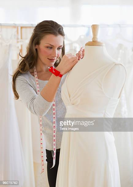 seamstress in bridal shop - dressmaker's model stock photos and pictures