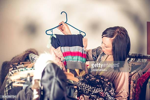Seamstress Selecting Clothes