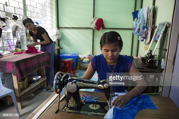 A seamstress sews a garment in Naypyidaw Myanmar on Wednesday Feb 3 2016 Myanmar's new popularly elected upper house of parliament voted Wednesday in...