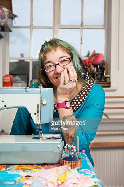 seamstress working at sewing machine. - craft stock pictures, royalty-free photos & images