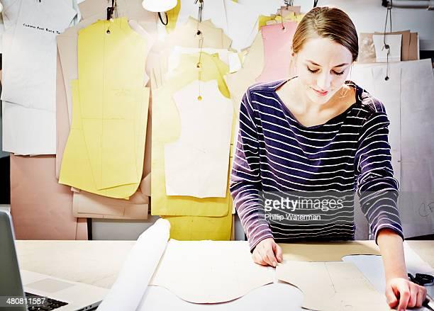 Seamstress working at table