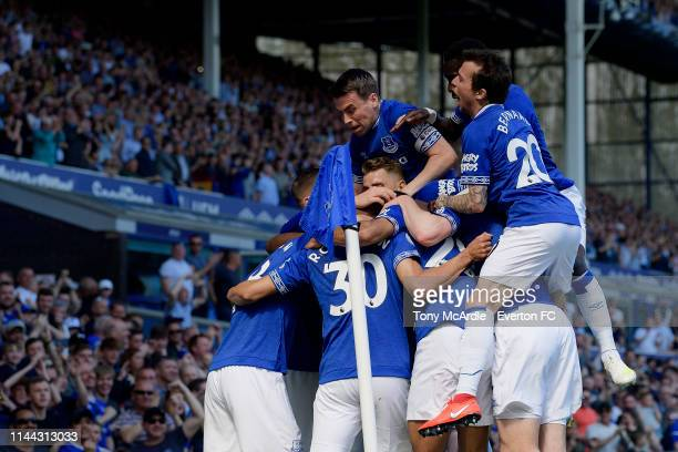 Seamus Coleman and Bernard of Everton celebrate the goal of Richarlison during the Premier League match between Everton FC and Manchester United at...