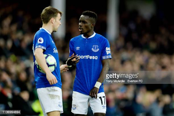 Seamus Coleman and Idrissa Gueye of Everton during the Premier League match between Everton and Chelsea at Goodison Park on March 17 2019 in...