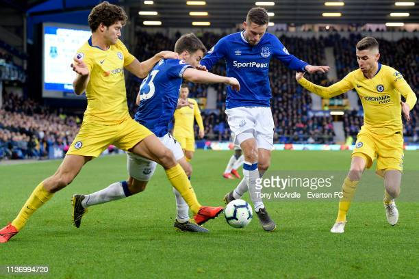 Seamus Coleman CL Gylfi Sigurdsson of Everton battle for the ball with Marcos Alonso and Jorginho during the Premier League match between Everton and...