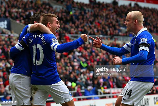 Seamus Coleman Gerard Deulofeu and Steven Naismith of Everton celebrate after Wes Brown of Sunderland scores an own goal during the Barclays Premier...