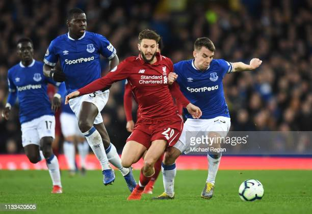 Seamus Coleman of Everton and Adam Lallana of Liverpool battle for the ball during the Premier League match between Everton FC and Liverpool FC at...