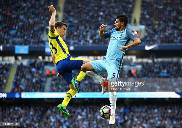Seamus Coleman of Everton and Ilkay Gundogan of Manchester City battle for possession in the air during the Premier League match between Manchester...