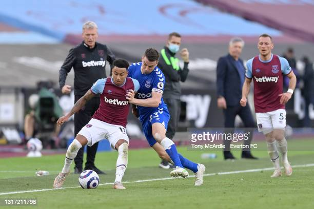 Seamus Coleman of Everton and Jesse Lingard challenge for the ball during the Premier League match between West Ham United and Everton at London...