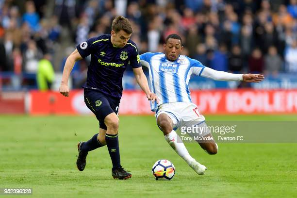 Seamus Coleman of Everton and Rajiv van La Parra challenge for the ball during the Premier League match between Huddersfield Town and Everton at the...