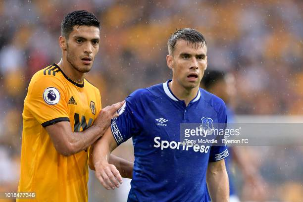 Seamus Coleman of Everton and Raul Jimenez during the Premier League match between Wolverhampton Wanderers and Everton FC at Molineux on August 11...