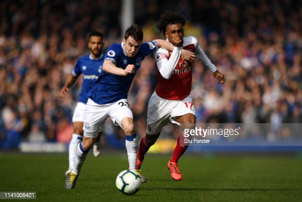 Seamus Coleman of Everton battles for possession with Alex Iwobi of Arsenal during the Premier League match between Everton FC and Arsenal FC at...