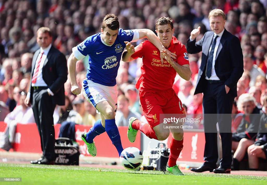 Seamus Coleman of Everton battles for the ball with Jordan Henderson of Liverpool during the Barclays Premier League match between Liverpool and Everton at Anfield on May 5, 2013 in Liverpool, England.