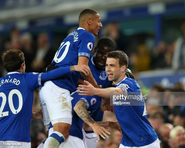 Seamus Coleman of Everton celebrates with team mates Richarlison and Bernard after scoring his team's second goal during the Premier League match...