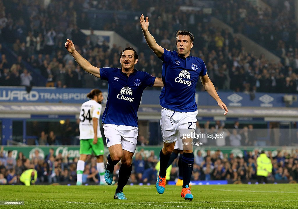 Seamus Coleman (R) of Everton celebrates with teammate Leighton Baines of Everton after scoring his team's second goal during the UEFA Europa League Group H match between Everton and VFL Wolfsburg on September 18, 2014 in Liverpool, United Kingdom.