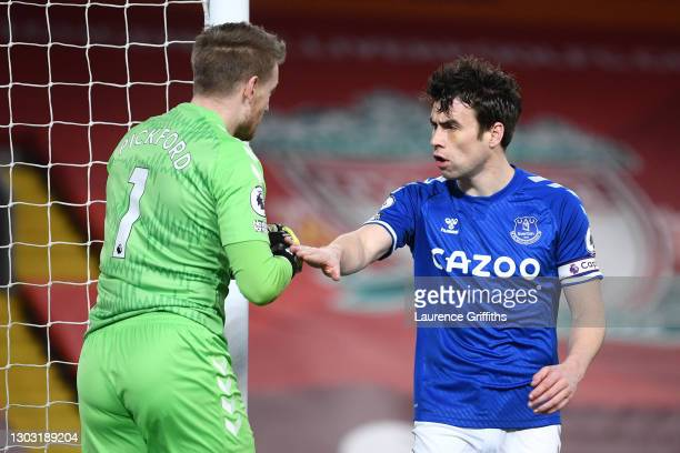 Seamus Coleman of Everton congratulates Jordan Pickford of Everton after a save during the Premier League match between Liverpool and Everton at...