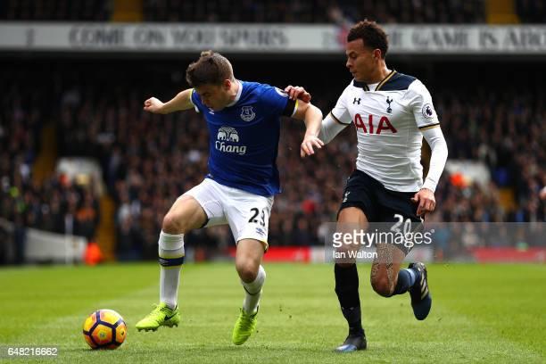 Seamus Coleman of Everton holds off Dele Alli of Tottenham Hotspur during the Premier League match between Tottenham Hotspur and Everton at White...