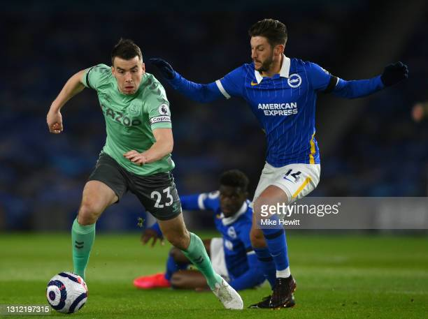 Seamus Coleman of Everton is challenged by Adam Lallana of Brighton & Hove Albion during the Premier League match between Brighton & Hove Albion and...