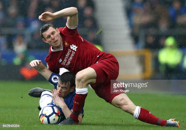 Seamus Coleman of Everton is challenged by James Milner of Liverpool during the Premier League match between Everton and Liverpool at Goodison Park...