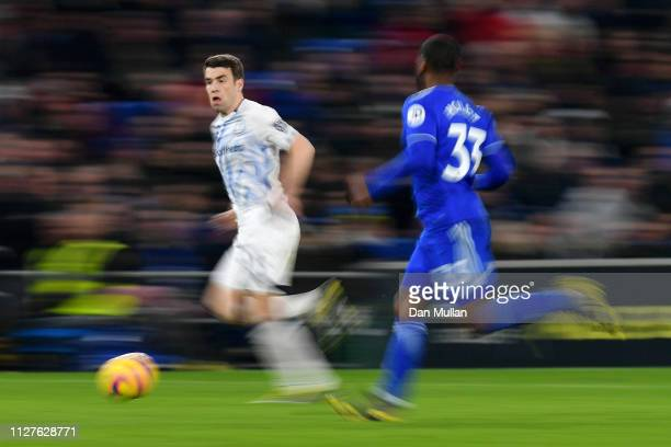 Seamus Coleman of Everton is chased by Junior Hoilett of Cardiff City during the Premier League match between Cardiff City and Everton FC at Cardiff...