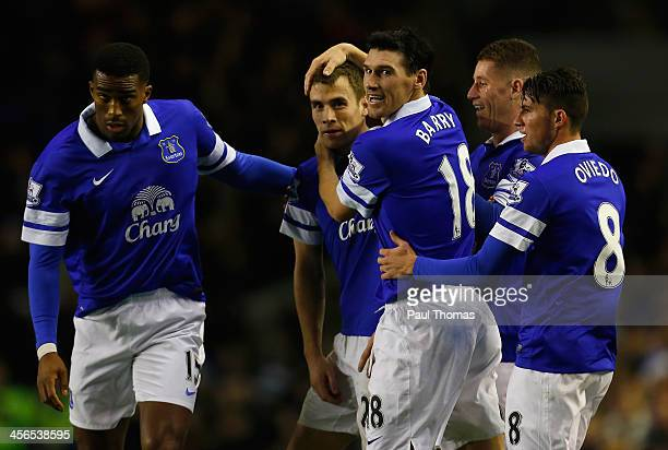 Seamus Coleman of Everton is congratulated by his team-mates after scoring his team's second goal during the Barclays Premier League match between...
