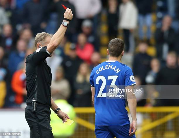Seamus Coleman of Everton is shown the red card during the Premier League match between Burnley FC and Everton FC at Turf Moor on October 05, 2019 in...