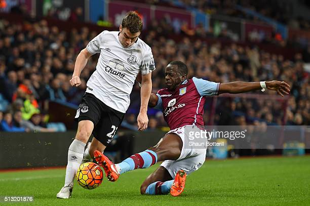 Seamus Coleman of Everton is tackled by Aly Cissokho of Aston Villa during the Barclays Premier League match between Aston Villa and Everton at Villa...