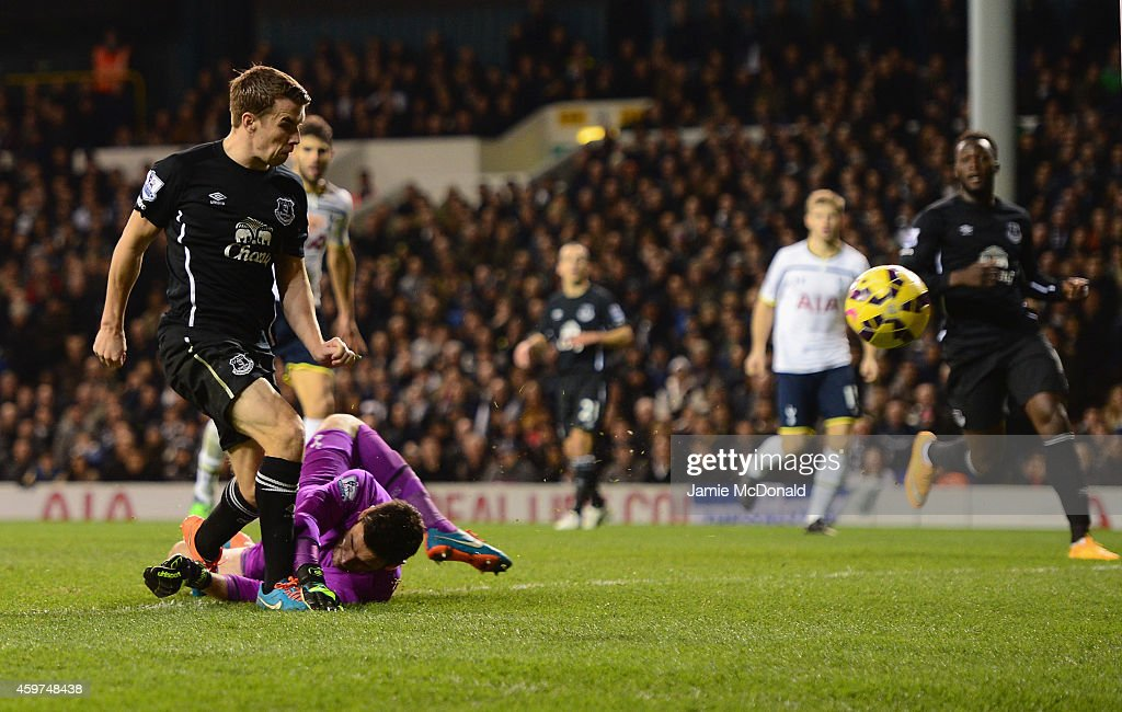 Seamus Coleman of Everton is tackled by Hugo Lloris of Spurs during the Barclays Premier League match between Tottenham Hotspur and Everton at White Hart Lane on November 30, 2014 in London, England.