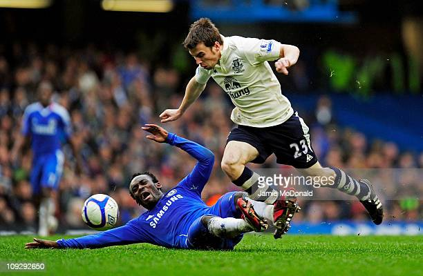 Seamus Coleman of Everton is tackled by Michael Essien of Chelsea during the FA Cup sponsored by EON 4th round replay match between Chelsea and...