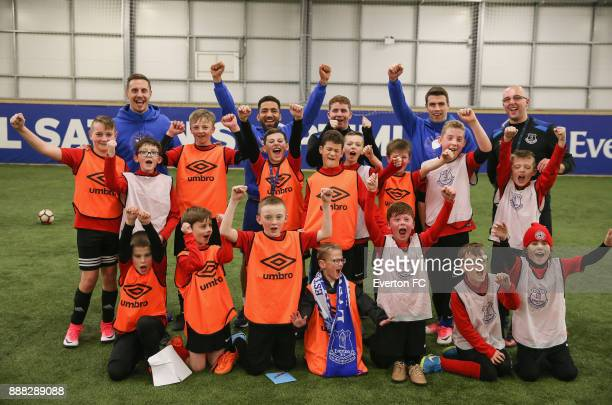 Seamus Coleman of Everton Phil Jagielka of Everton Aaron Lennon of Everton pose with the team during the Coaching Session With a Junior Teama at USM...