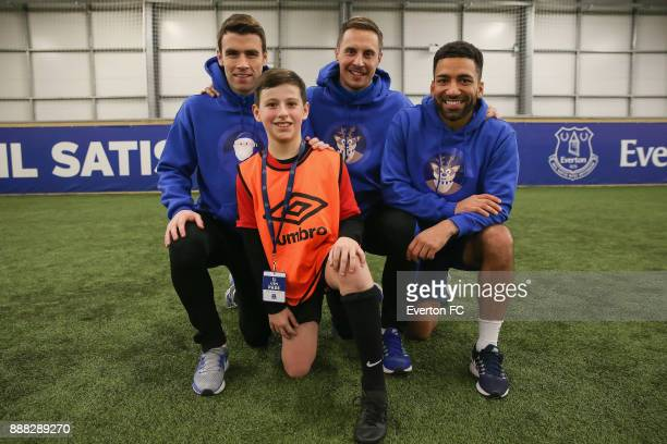 Seamus Coleman of Everton Phil Jagielka of Everton Aaron Lennon of Everton pose with a fan during the Coaching Session With a Junior Teama at USM...