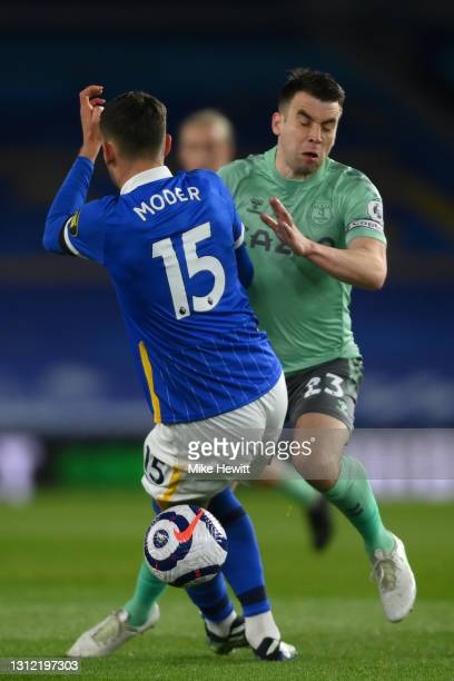 Seamus Coleman of Everton runs into Jakub Moder of Brighton & Hove Albion during the Premier League match between Brighton & Hove Albion and Everton...