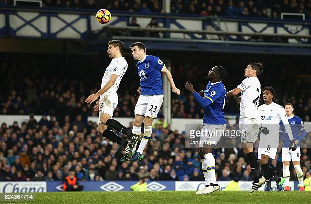 Seamus Coleman of Everton scores his sides first goal via a header during the Premier League match between Everton and Swansea City at Goodison Park...