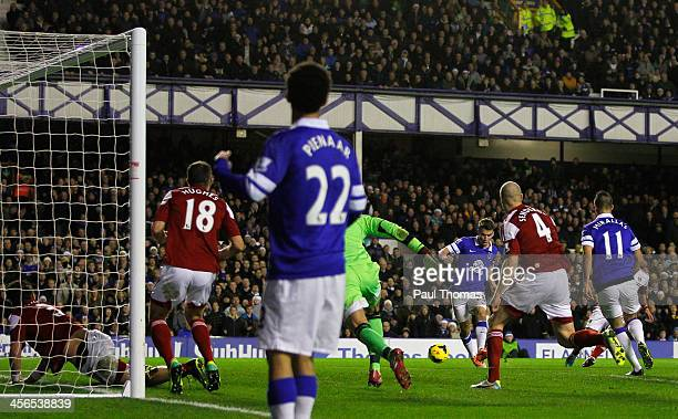 Seamus Coleman of Everton scores his team's second goal during the Barclays Premier League match between Everton and Fulham at Goodison Park on...