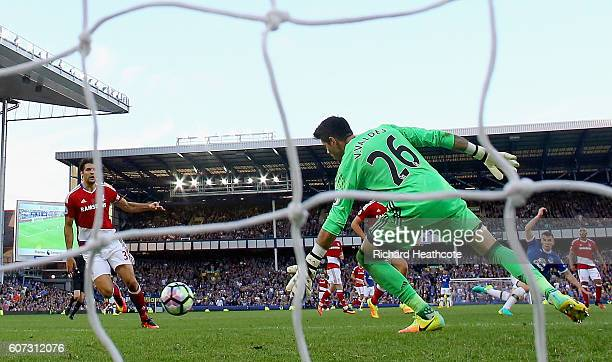 Seamus Coleman of Everton scores their second goal past goalkeeper Victor Valdes of Middlesbrough during the Premier League match between Everton and...